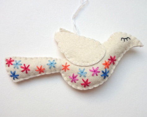 White felt bird with colorful embroidery