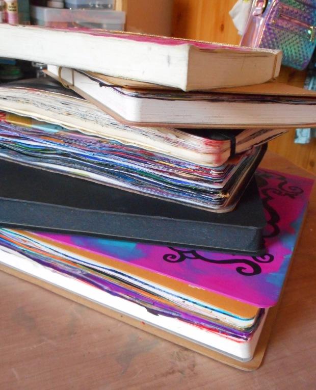 a pile of art journals