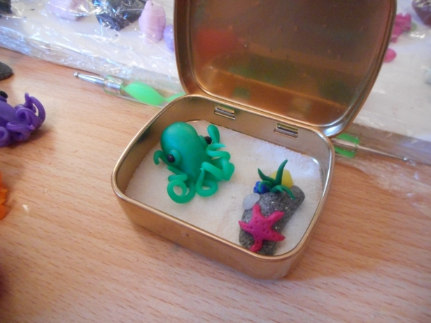 green clay octopus in tin